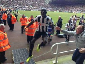 Cisse prepares to leap into the crowd following his winner